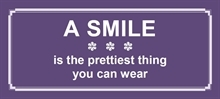 Postkort - A smile is the......